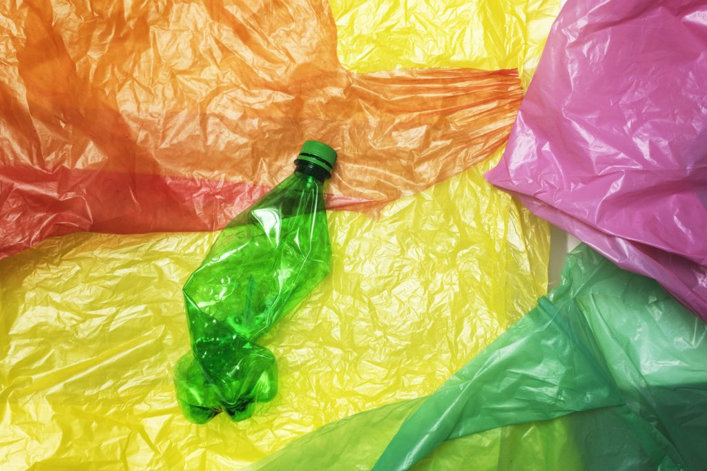 Disposable plastic bottle on plastic bags